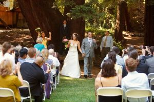 The 200-foot, 500-year old old-growth redwood, circa 2010, directly behind the bride.